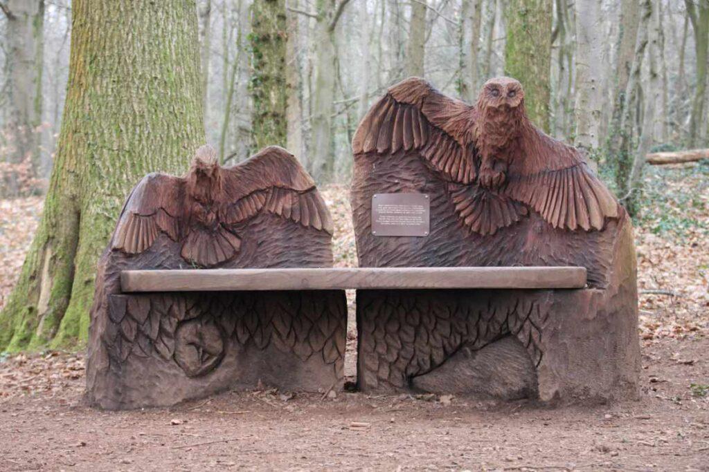 Wooden bench with bird sculptures