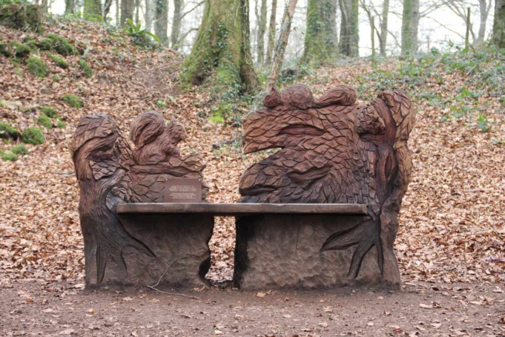 Wooden sculpture of animals on a bench