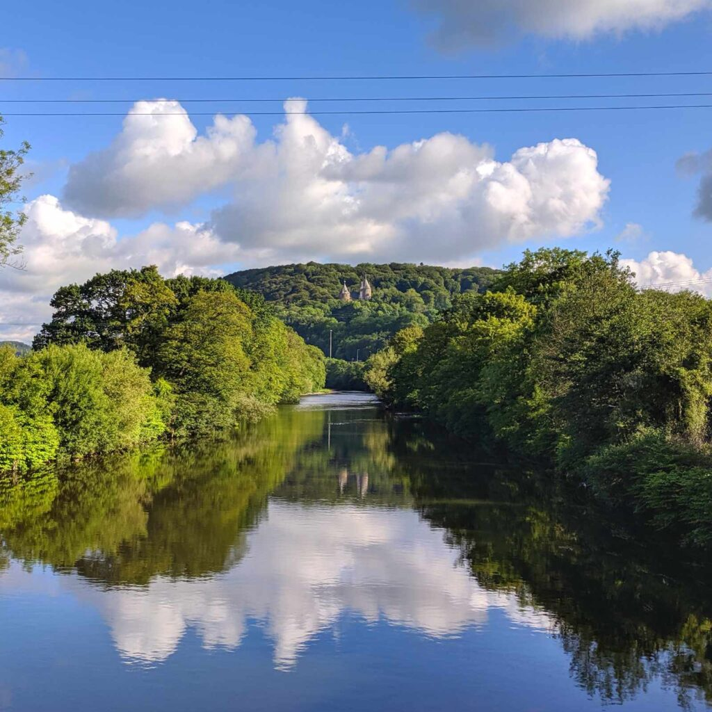 Castell Coch on the River Taff with large white clouds