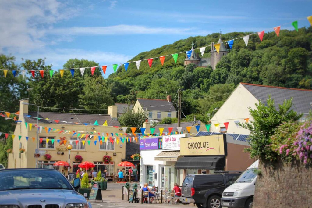 Tongwynlais square with bunting across the roads and Castell Coch in the distance