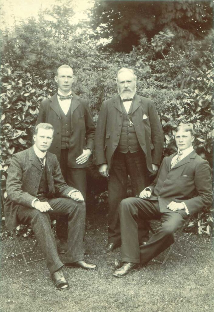 Andrew Pettigrew and three sons at home